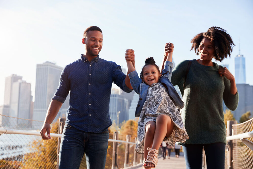 young family walking on footbridge